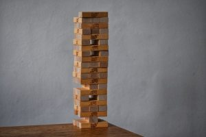 A tower of Jenga blocks on a table.