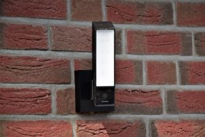 A device installed on a brick wall